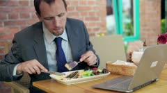 Businessman eating lunch in cafe, outdoor Stock Footage
