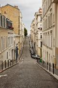 Narrow street in monmartre in gloomy day Stock Photos