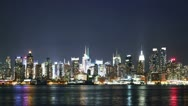 Time lapse and loopable view of Manhattan skyline from New Jersey at night Stock Footage