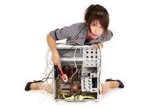 woman cleaning computer - stock photo