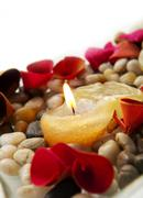 candle and petals - stock photo