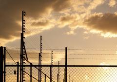 sunset fence - stock photo