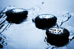 Stock Photo of shiny zen stones with water drops