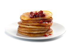 sweet pancakes with strawberry jam isolated - stock photo
