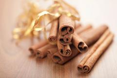 Cinnamon with golden ribbon Stock Photos