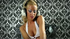 Blonde gogo with headphones Stock Footage