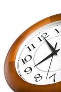 Round clock showing nine isolated Stock Photos