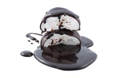 Marshmallows in chocolate syrup isolated Stock Photos