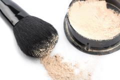 powder and black brush isolated - stock photo