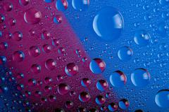blue and pink water drops background - stock photo