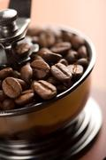 Roasted coffee beans in coffee grinder Stock Photos