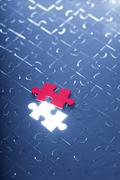 blue puzzle with one red piece - stock photo