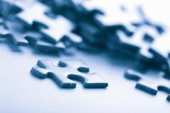 Blue puzzle pieces Stock Photos