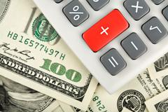 dollars and calculator with plus red button - stock photo