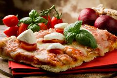 pizza with cherry tomatoes and buffalo mozzarella - stock photo