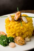 risotto with saffron and seafood - stock photo