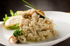 risotto with seafood - stock photo