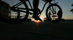Wide shot bikes on the Mission Beach boardwalk in San Diego Stock Footage