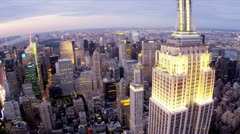 Stock Video Footage of Aerial illuminated view Empire State Building, Upper West Manhattan, New York, U