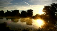 The sun is rising. Mist on the lake in the sunny morning, fog and sun, landscape - stock footage