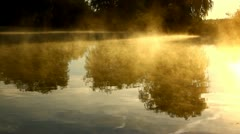 Water surface with mist in the morning, sun, lake Stock Footage