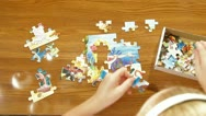Child Assemble Jigsaw Puzzle Stock Footage