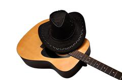 Stock Photo of acoustic guitar and hat