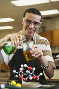 Mixed Race teenaged boy in science class Stock Photos