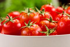 Stock Photo of tomatoes inside white bowl