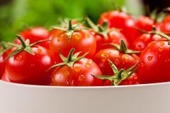 tomatoes inside white bowl - stock photo