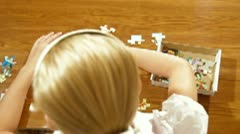 Child Assemble Jigsaw Puzzle - stock footage