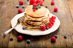 Pancakes on wooden table Stock Photos