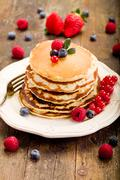 pancakes on wooden table - stock photo