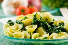 Orecchiette with turnip tops Stock Photos