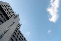 scene - office building and cloud - stock photo
