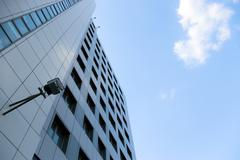 urban scene - office building and cloud - stock photo