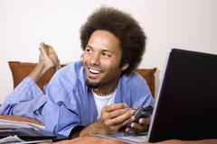 African man using electronic organizer Stock Photos