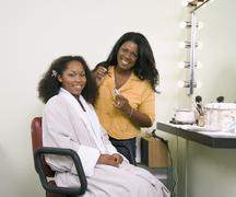 Stock Photo of African woman having makeup applied