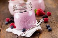 small jars with homemade yogurt with berries - stock photo