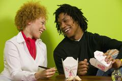 African couple eating takeout food Stock Photos