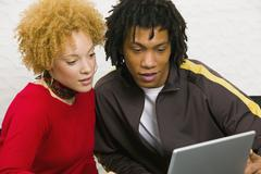 African couple looking at laptop Stock Photos