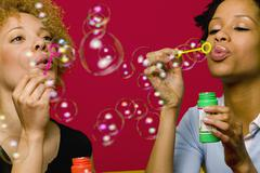 African women blowing bubbles Stock Photos