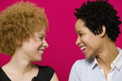 African women smiling at each other Stock Photos