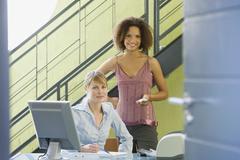 Stock Photo of Multi-ethnic businesswomen behind desk