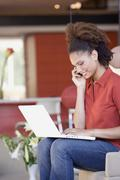 Stock Photo of African woman typing on laptop