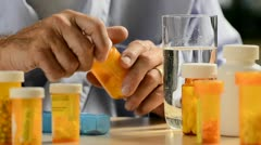 Senior man with medication 7 Stock Footage