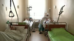 Nurse caring for a sick patient 2 Stock Footage