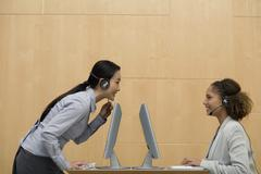 Stock Photo of Multi-ethnic businesswomen wearing headsets