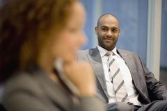African businessman looking at coworker Stock Photos