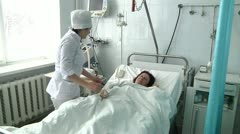 Nurse caring for a sick patient 5 Stock Footage